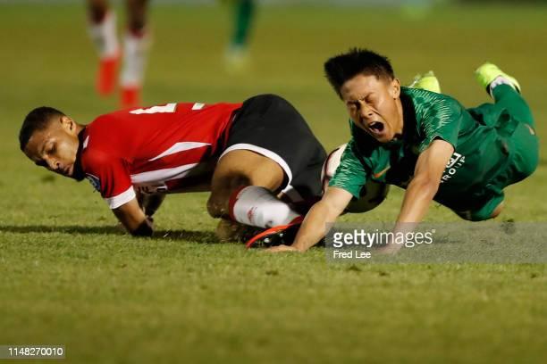 Daniels of PSV U17 and Zhou Wenfeng in action during the 2019 Sinobo Guoan Cup U18 between Beijing Guoan and PSV at Sinobo Guoan Shunyi Training Base...