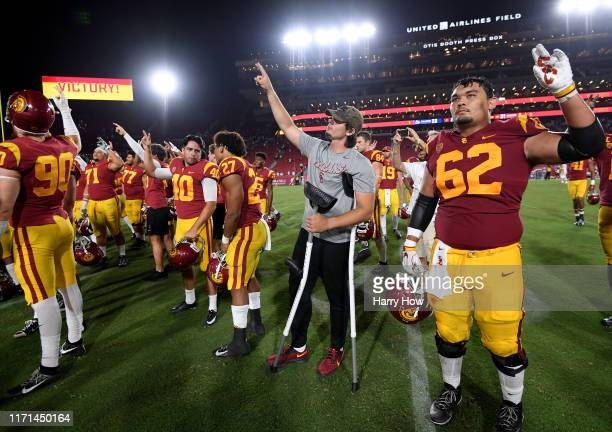 Daniels of the USC Trojans in crutches celebrates a 3123 win over Fresno State Bulldogs at Los Angeles Memorial Coliseum on August 31 2019 in Los...