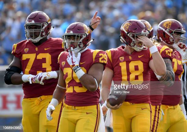 Daniels of the USC Trojans reacts with Vavae Malepeai and Austin Jackson after a stop on third down by the UCLA Bruins defense during the first half...