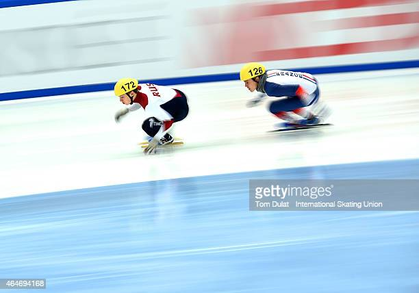 Daniil Eybog of Russia and Quentin Fercoq of France compete in Men's 500m race during day two of the ISU World Junior Short Track Speed Skating...