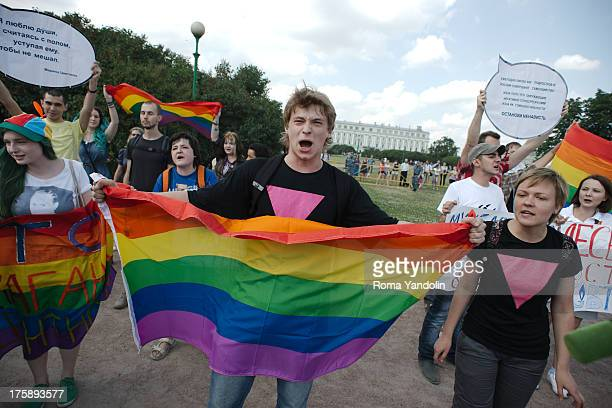 Daniil Grachev, a gay rights activist, holds a rainbow flag and reacts during a Gay Pride event in St. Petersburg, June 29, 2013. Demonstrating LGBT...