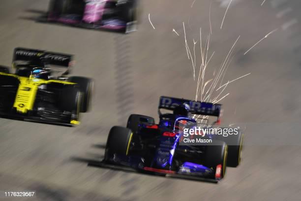 Daniil Kvyat driving the Scuderia Toro Rosso STR14 Honda and Daniel Ricciardo of Australia driving the Renault Sport Formula One Team RS19 battle for...
