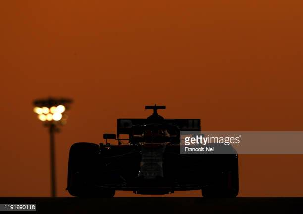 Daniil Kvyat driving the Scuderia Toro Rosso STR14 Honda during day one of F1 End of Season Testing in Abu Dhabi at Yas Marina Circuit on December...