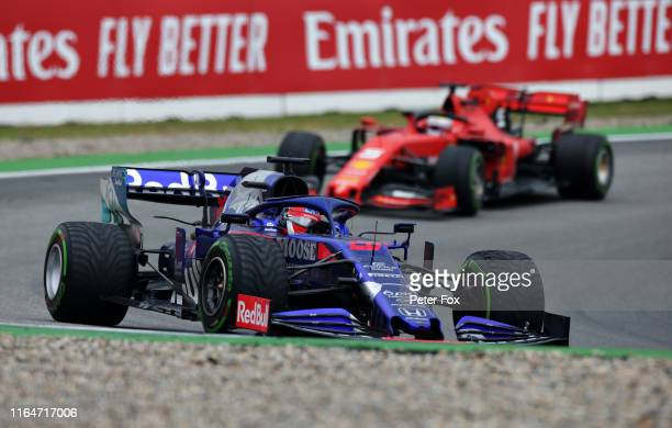 Daniil Kvyat driving the Scuderia Toro Rosso STR14 Honda leads Sebastian Vettel of Germany driving the Scuderia Ferrari SF90 on track during the F1...