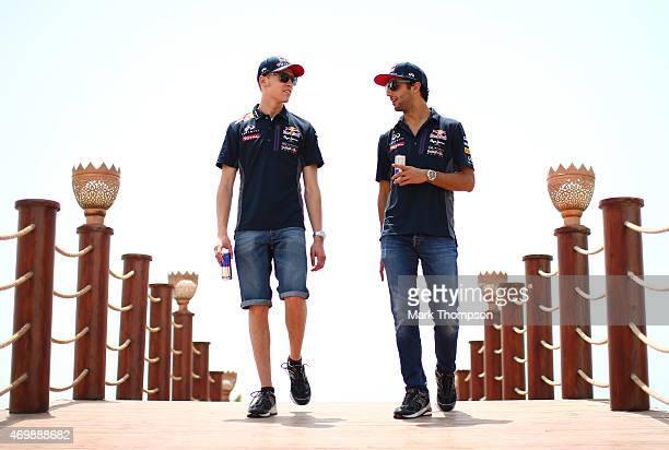 Daniil Kvyat of Russia and Infiniti Red Bull Racing and Daniel Ricciardo of Australia and Infiniti Red Bull Racing arrive for an interview during...