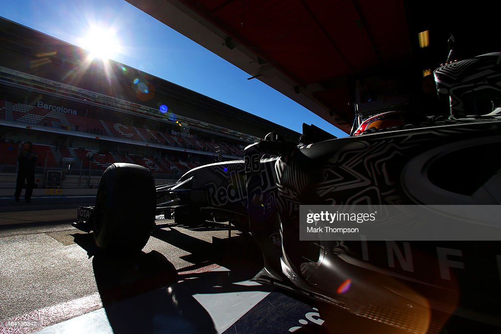 Daniil Kvyat of Russia and Infiniti Red Bull Racing exits the garage during day four of Formula One Winter Testing at Circuit de Catalunya on February 22, 2015 in Montmelo, Spain.