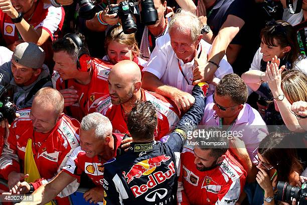 Daniil Kvyat of Russia and Infiniti Red Bull Racing is congratulated by Infiniti Red Bull Racing Team Consultant Dr Helmut Marko in Parc Ferme after...