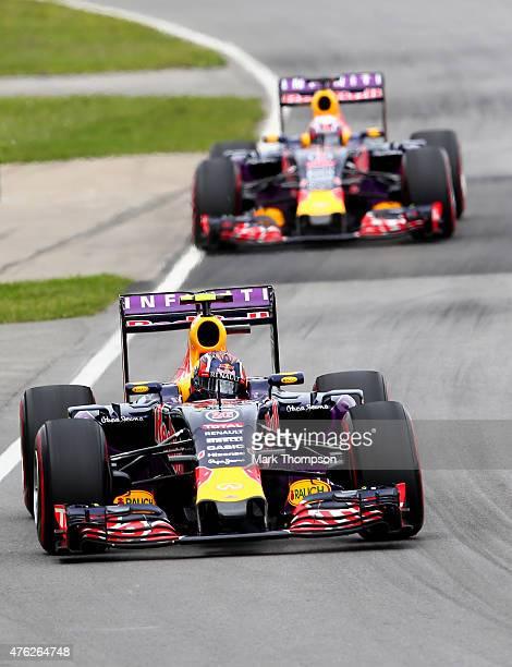 Daniil Kvyat of Russia and Infiniti Red Bull Racing is pursued by teammate Daniel Ricciardo of Australia and Infiniti Red Bull Racing during the...
