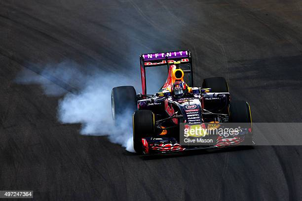Daniil Kvyat of Russia and Infiniti Red Bull Racing locks up during the Formula One Grand Prix of Brazil at Autodromo Jose Carlos Pace on November 15...