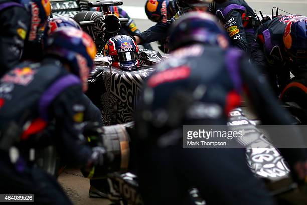 Daniil Kvyat of Russia and Infiniti Red Bull Racing returns to the garage for a tyre change during day three of Formula One Winter Testing at Circuit...