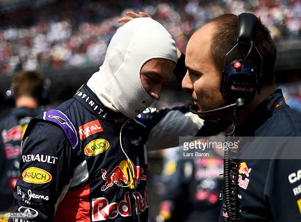 Daniil Kvyat of Russia and Infiniti Red Bull Racing speaks with his race engineer Gianpiero Lambiase on the grid before the Formula One Grand Prix of...