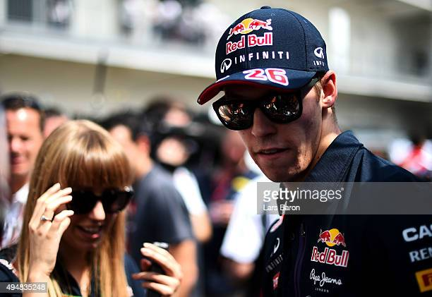 Daniil Kvyat of Russia and Infiniti Red Bull Racing speaks with members of the media in the paddock during previews to the Formula One Grand Prix of...