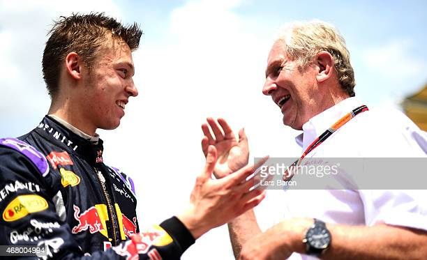 Daniil Kvyat of Russia and Infiniti Red Bull Racing speaks with team consultant Dr Helmut Marko on the grid before the Malaysia Formula One Grand...