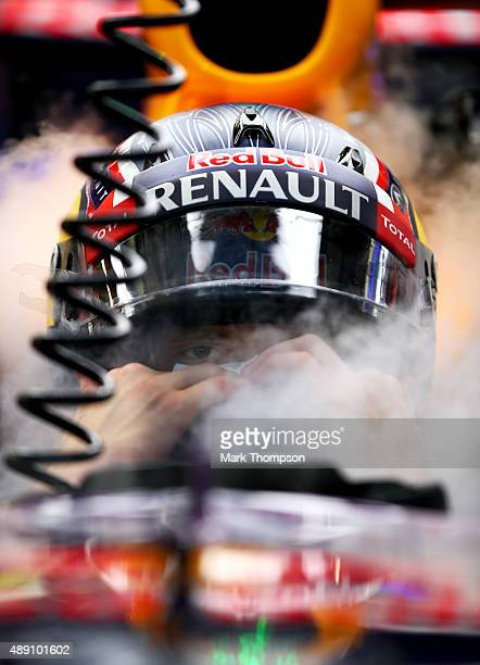Daniil Kvyat of Russia and Infiniti Red Bull Racing uses dry ice to keep cool in his car as he waits in the garage during final practice for the...