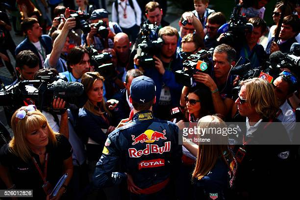 Daniil Kvyat of Russia and Red Bull Racing talks to the press during practice for the Formula One Grand Prix of Russia at Sochi Autodrom on April 29,...