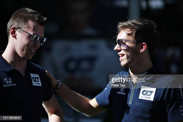 Daniil Kvyat of Russia and Scuderia AlphaTauri and Pierre Gasly of France and Scuderia AlphaTauri talk in the Paddock during previews ahead of the F1...