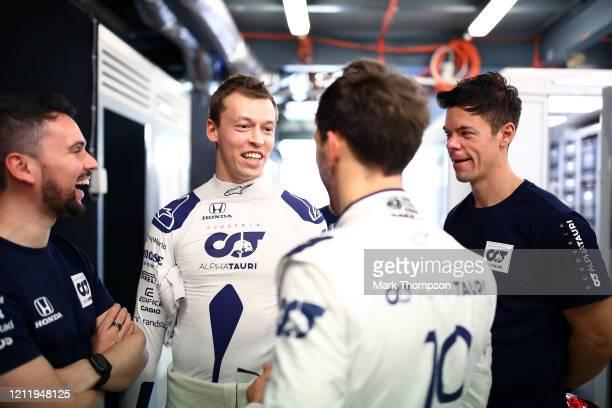 Daniil Kvyat of Russia and Scuderia AlphaTauri and Pierre Gasly of France and Scuderia AlphaTauri speak in the garage during previews ahead of the F1...