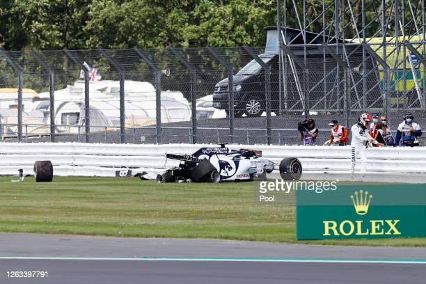 Daniil Kvyat of Russia and Scuderia AlphaTauri walks away from his car after crashing into a track barrier during the F1 Grand Prix of Great Britain...