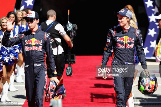 Daniil Kvyat of Russia and Scuderia Toro Rosso and Brendon Hartley of New Zealand and Scuderia Toro Rosso walk to the grid before the United States...