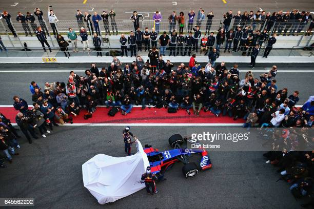 Daniil Kvyat of Russia and Scuderia Toro Rosso and Carlos Sainz of Spain and Scuderia Toro Rosso unveil the Scuderia Toro Rosso STR12 to the media in...