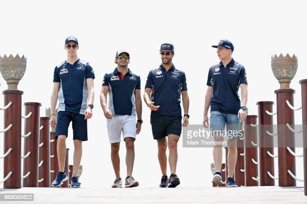 Daniil Kvyat of Russia and Scuderia Toro Rosso Carlos Sainz of Spain and Scuderia Toro Rosso Daniel Ricciardo of Australia and Red Bull Racing and...