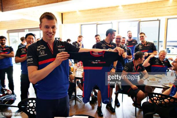 Daniil Kvyat of Russia and Scuderia Toro Rosso is presented with gifts for his new baby by the Scuderia Toro Rosso team during previews ahead of the...