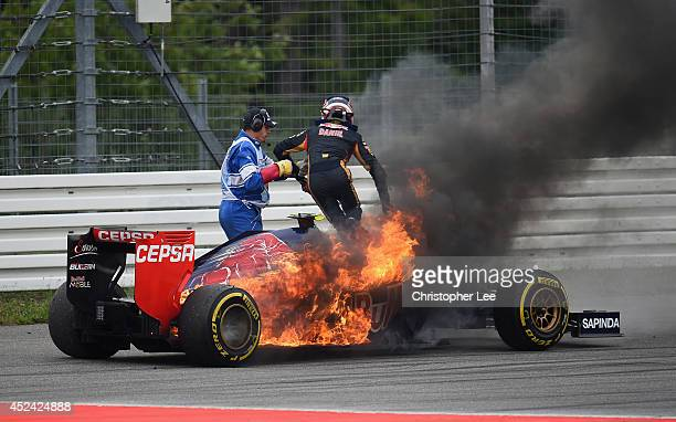 Daniil Kvyat of Russia and Scuderia Toro Rosso jumps out of his car after it caught fire during the German Grand Prix at Hockenheimring on July 20,...