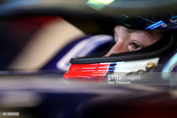 Daniil Kvyat of Russia and Scuderia Toro Rosso sits in his car in the garage during day two of testing at Silverstone Circuit on July 9 2014 in...