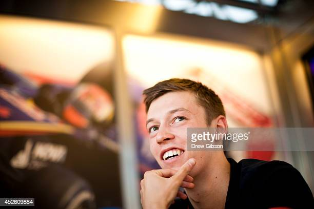 Daniil Kvyat of Russia and Scuderia Toro Rosso speaks with members of the media during previews ahead of the Hungarian Formula One Grand Prix at...