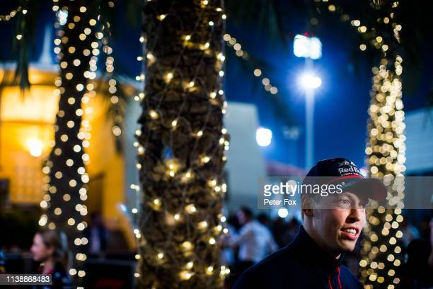 Daniil Kvyat of Russia and Scuderia Toro Rosso talks to the media in the Paddock during previews ahead of the F1 Grand Prix of Bahrain at Bahrain...