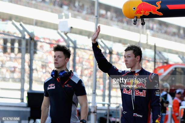 Daniil Kvyat of Russia and Scuderia Toro Rosso waves to the crowd from the pit lane during qualifying for the Formula One Grand Prix of Russia on...