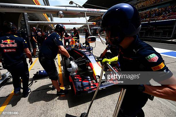 Daniil Kvyat of Russia driving the Red Bull Racing Red BullTAG Heuer RB12 TAG Heuer comes into the pits during practice for the Formula One Grand...