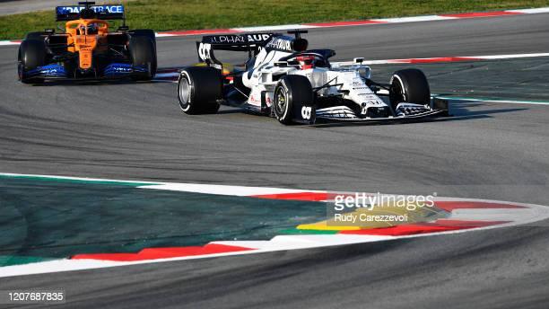 Daniil Kvyat of Russia driving the Scuderia AlphaTauri AT01 Honda leads Carlos Sainz of Spain driving the McLaren F1 Team MCL35 Renault on track...