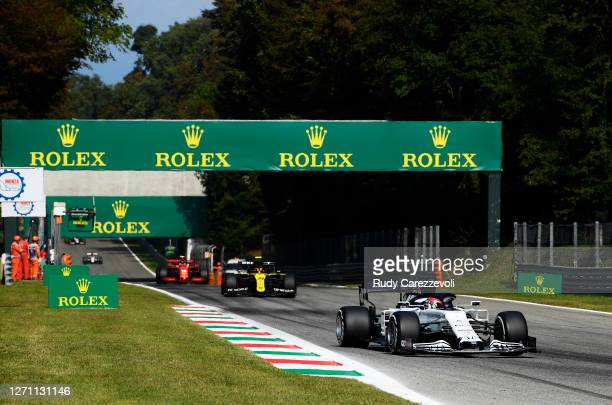 Daniil Kvyat of Russia driving the Scuderia AlphaTauri AT01 Honda leads Esteban Ocon of France driving the Renault Sport Formula One Team RS20 and...