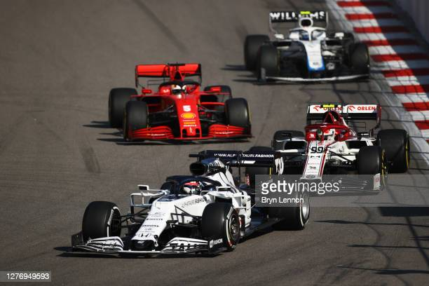 Daniil Kvyat of Russia driving the Scuderia AlphaTauri AT01 Honda leads Antonio Giovinazzi of Italy driving the Alfa Romeo Racing C39 Ferrari during...