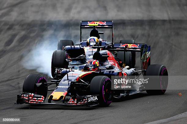 Daniil Kvyat of Russia driving the Scuderia Toro Rosso STR11 Ferrari 060/5 turbo leads Carlos Sainz of Spain driving the Scuderia Toro Rosso STR11...