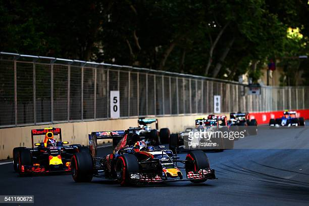 Daniil Kvyat of Russia driving the Scuderia Toro Rosso STR11 Ferrari 060/5 turbo leads Max Verstappen of the Netherlands driving the Red Bull Racing...