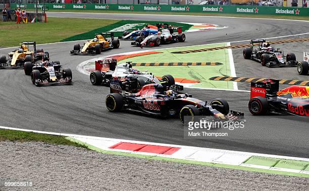 Daniil Kvyat of Russia driving the Scuderia Toro Rosso STR11 Ferrari 060/5 turbo Romain Grosjean of France driving the Haas F1 Team HaasFerrari VF16...