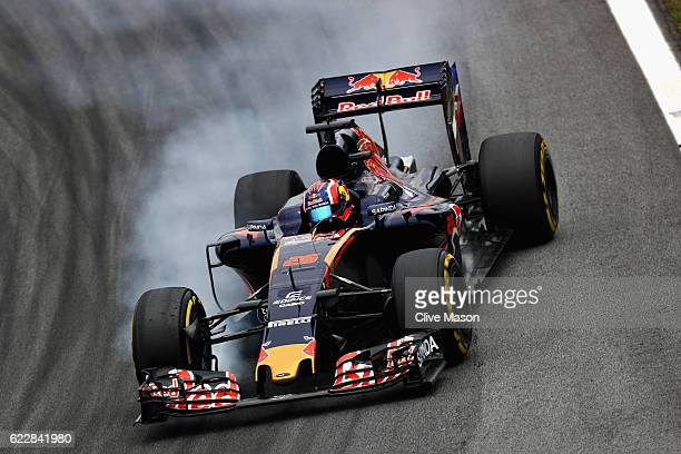 Daniil Kvyat of Russia driving the Scuderia Toro Rosso STR11 Ferrari 060/5 turbo locks a wheel under braking on track during qualifying for the...