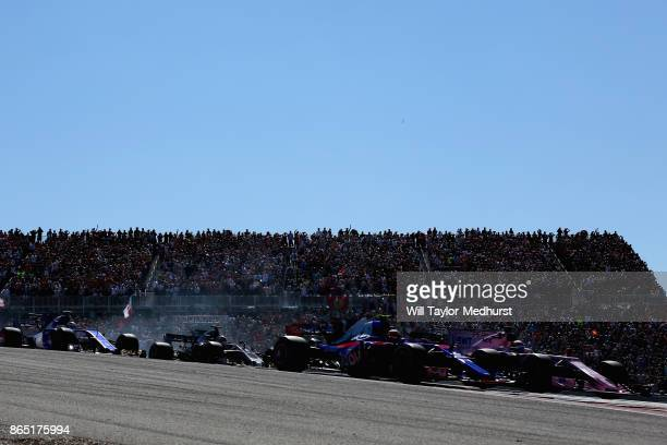 Daniil Kvyat of Russia driving the Scuderia Toro Rosso STR12 and Sergio Perez of Mexico driving the Sahara Force India F1 Team VJM10 at the start...