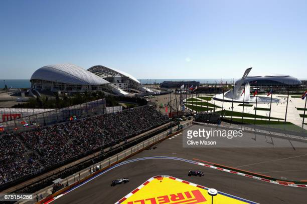 Daniil Kvyat of Russia driving the Scuderia Toro Rosso STR12 leads Lance Stroll of Canada driving the Williams Martini Racing Williams FW40 Mercedes...