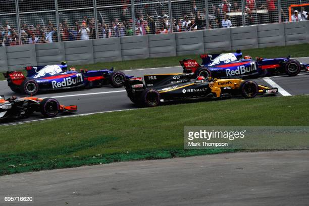 Daniil Kvyat of Russia driving the Scuderia Toro Rosso STR12 Nico Hulkenberg of Germany driving the Renault Sport Formula One Team Renault RS17 and...