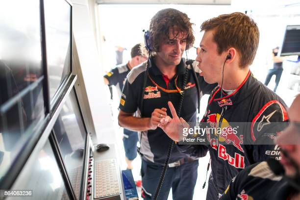 Daniil Kvyat of Scuderia Toro Rosso and Russia chats with his new Race Engineer Marco Matassa of Scuderia Toro Rosso and Italy during practice for...