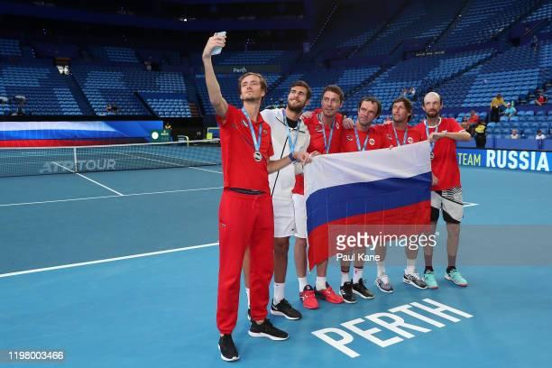 Daniil Medvedev Karen Khachanov Marat Safin Teymuraz Gabashvili Ivan Nedelko and Konstantin Kravchuk of Team Russia take a selfie after winning the...