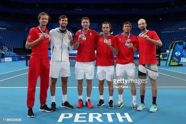 Daniil Medvedev Karen Khachanov Marat Safin Teymuraz Gabashvili Ivan Nedelko and Konstantin Kravchuk of Team Russia pose with their ATP medals after...