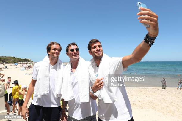 Daniil Medvedev Marat Safin and Karen Khachanov of Team Russia take a selfie ahead following a media opportunity ahead of the 2020 ATP Cup Group...