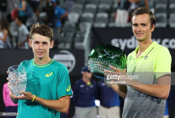 Daniil Medvedev of Russia and Alex de Minaur of Australia pose with the winners and runners up trophies after the Men's Singles Final match during...