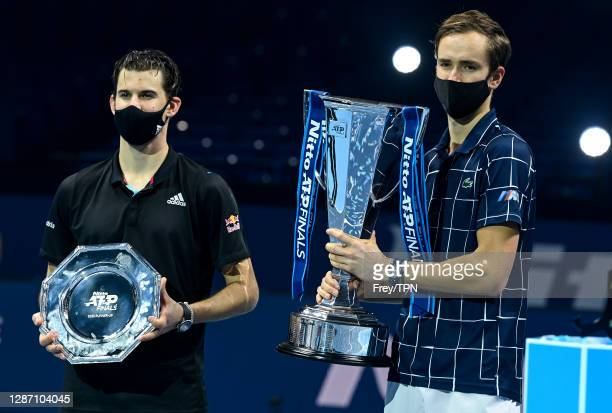 Daniil Medvedev of Russia and Dominic Thiem of Austria pose with their trophies after the final on Day 8 of the Nitto ATP World Tour Finals at The O2...