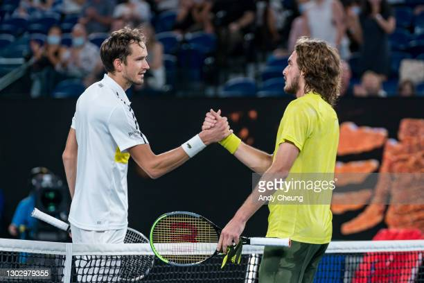 Daniil Medvedev of Russia and Stefanos Tsitsipas of Greece embrace at the net following their Men's Singles Semifinals match during day 12 of the...