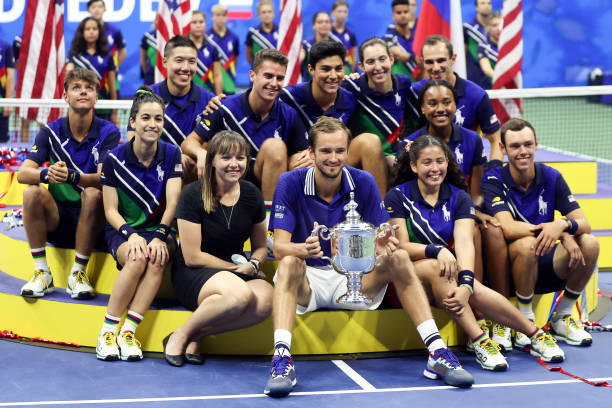 Daniil Medvedev of Russia celebrates with the championship trophy alongside ball kids after defeating Novak Djokovic of Serbia to win the Men's...